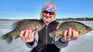A happy client with a couple of nice crappies from the day!