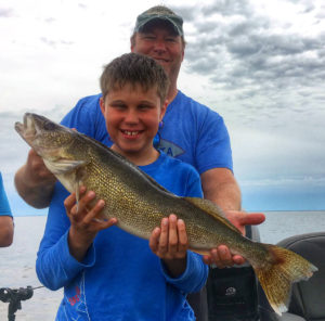 Young man with a walleye