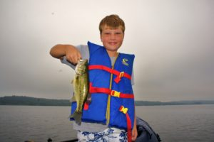 Young man with a Largemouth bass caught on a Hackensack area lake