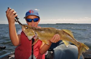 One happy young fisherman with a great walleye!